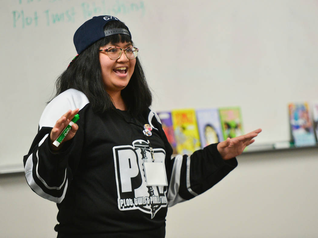 Jean Munson, 31, with Plot Twist Publishing, a Las Vegas based comic book publisher, teaches a class on drawing at the 11th annual Vegas Valley Comic Book Festival at the Clark County Library in L ...