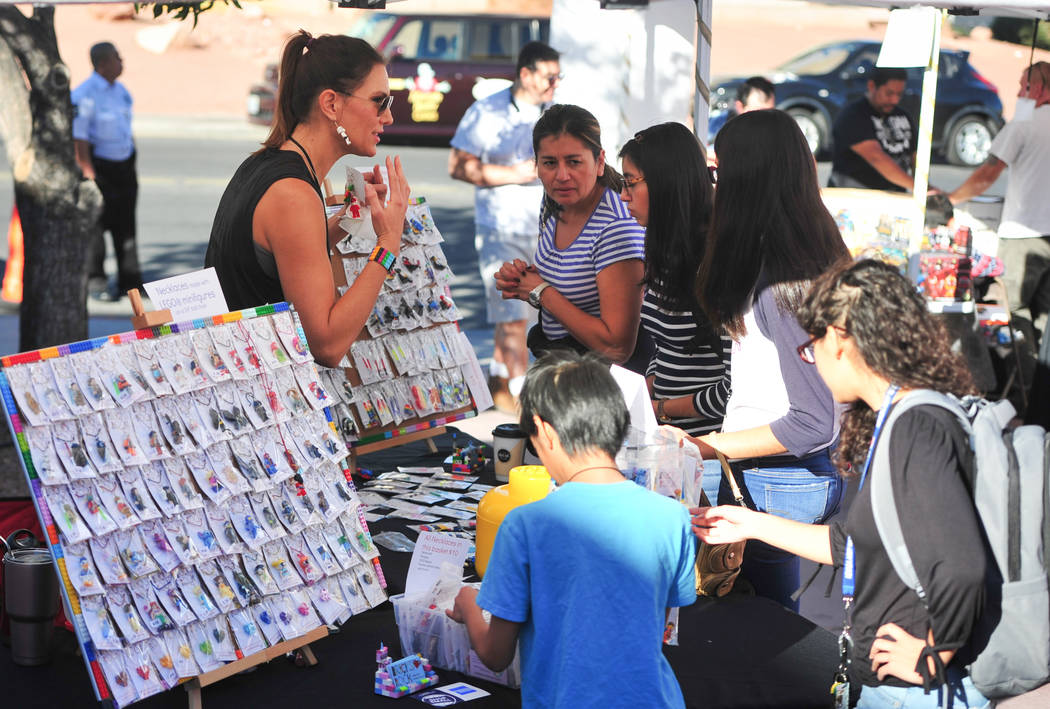 Kellee Reid, left, talks to customers at the 11th annual Vegas Valley Comic Book Festival at the Clark County Library in Las Vegas on Saturday, Nov. 3, 2018. Reid has been making jewelry out of Le ...