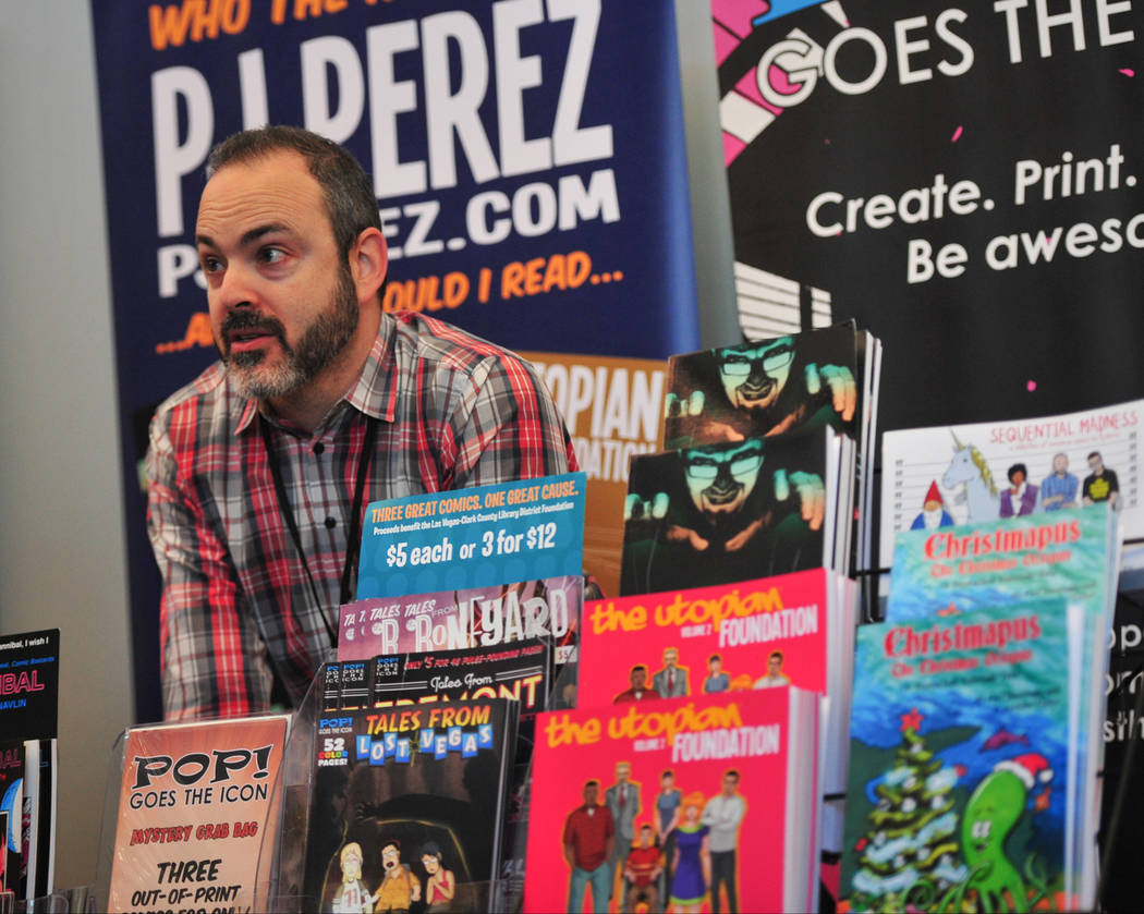 Pj Perez talks to a customer at the 11th annual Vegas Valley Comic Book Festival at the Clark County Library in Las Vegas on Saturday, Nov. 3, 2018. Brett Le Blanc Las Vegas Review-Journal