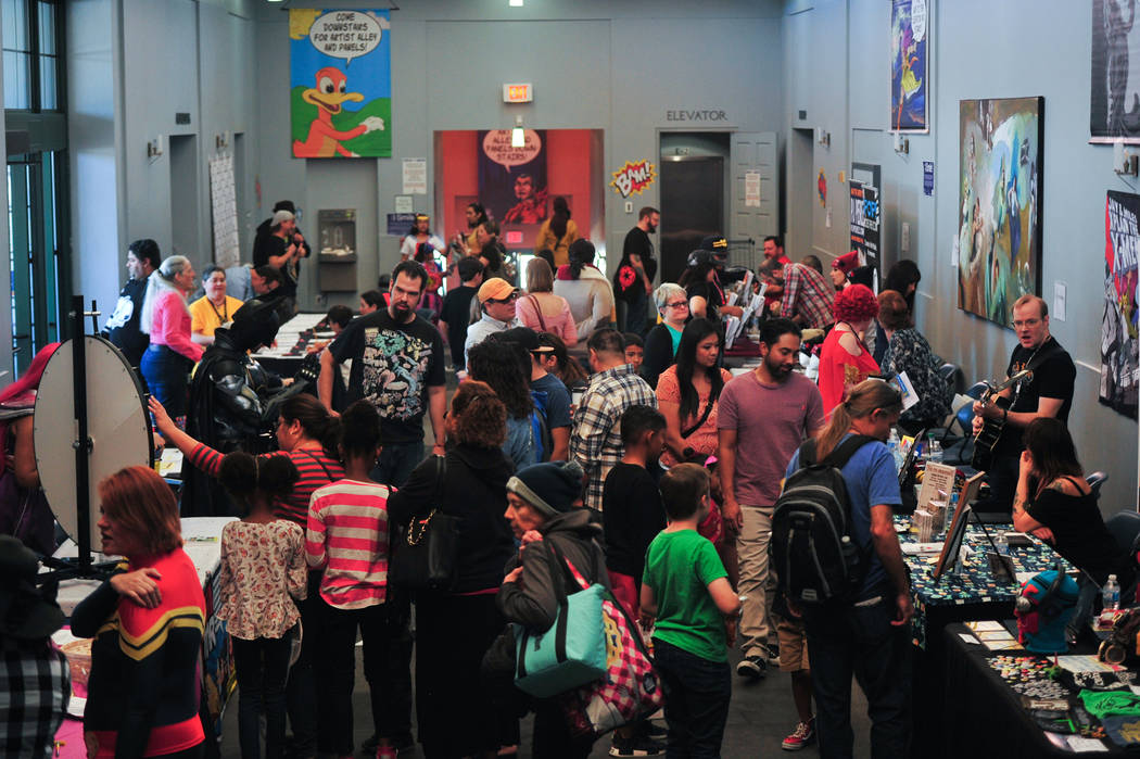 Comic book fans talk to artists and sellers at the 11th annual Vegas Valley Comic Book Festival at the Clark County Library in Las Vegas on Saturday, Nov. 3, 2018. Brett Le Blanc Las Vegas Review- ...