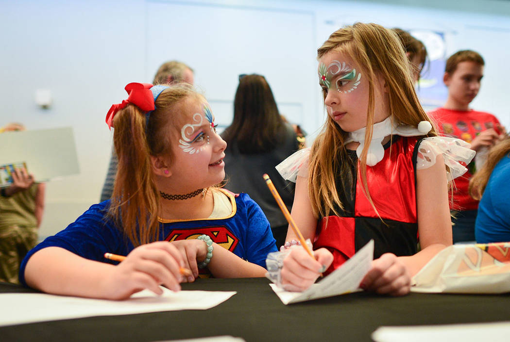 Izabella, left, and Dalayla, right, both eight, make drawings during at the 11th annual Vegas Valley Comic Book Festival at the Clark County Library in Las Vegas on Saturday, Nov. 3, 2018. Brett L ...