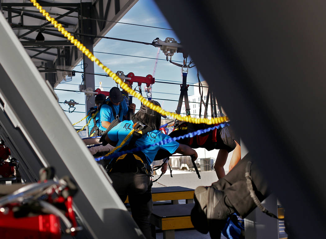 Workers prepare guests for the new Fly Linq Zipline at the Linq Hotel in Las Vegas, Thursday, Nov. 1, 2018. Participants start at the Strip, then fly over the Linq Promenade towards the Linq High ...
