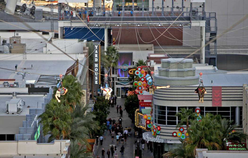 Guests on the new Fly Linq Zipline at the Linq Hotel in Las Vegas, Thursday, Nov. 1, 2018. Participants start at the Strip, then fly over the Linq Promenade towards the Linq High Roller. Rachel As ...