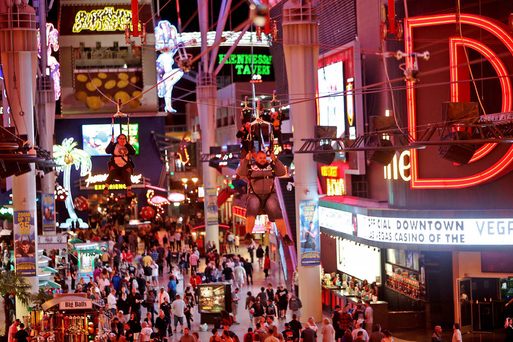 Guests cross the SlotZilla Zipline at the Fremont Street Experience in Las Vegas, Thursday, Nov. 1, 2018. Participants start near Las Vegas Boulevard, then fly over crowds and casinos to the other ...