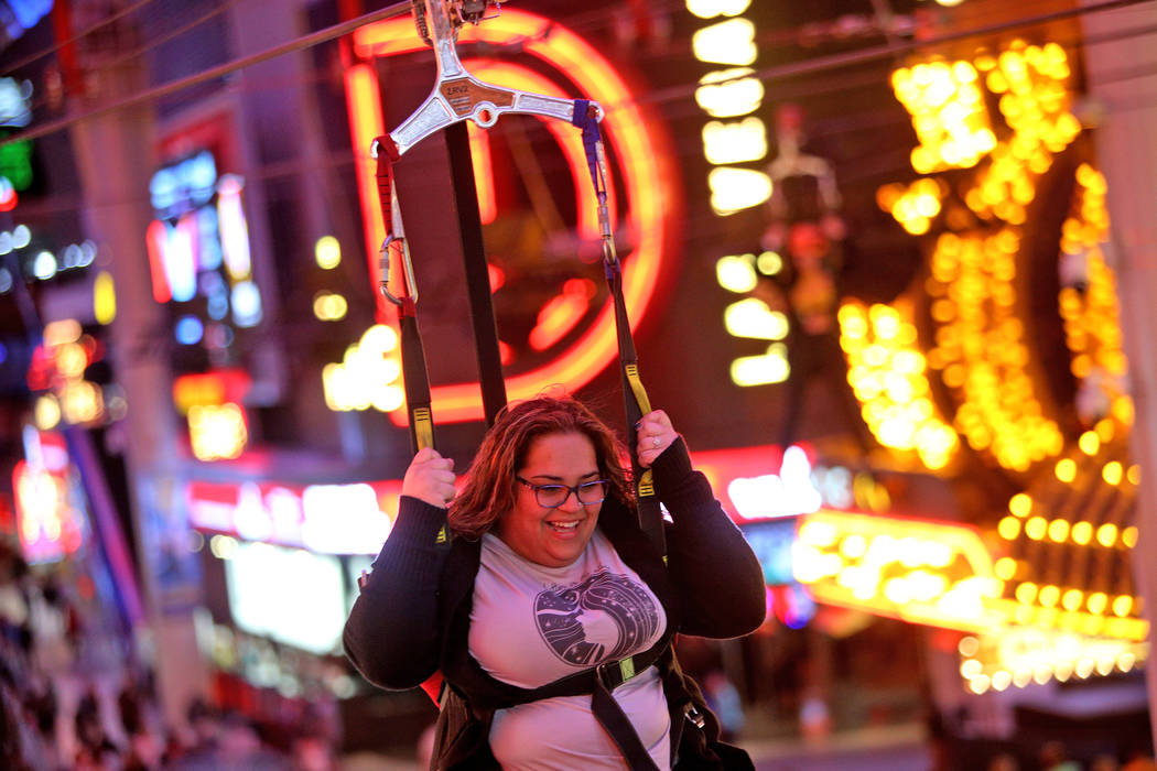 Maidelys Salas on the SlotZilla Zipline at the Fremont Street Experience in Las Vegas, Thursday, Nov. 1, 2018. Participants start near Las Vegas Boulevard, then fly over crowds and casinos to the ...
