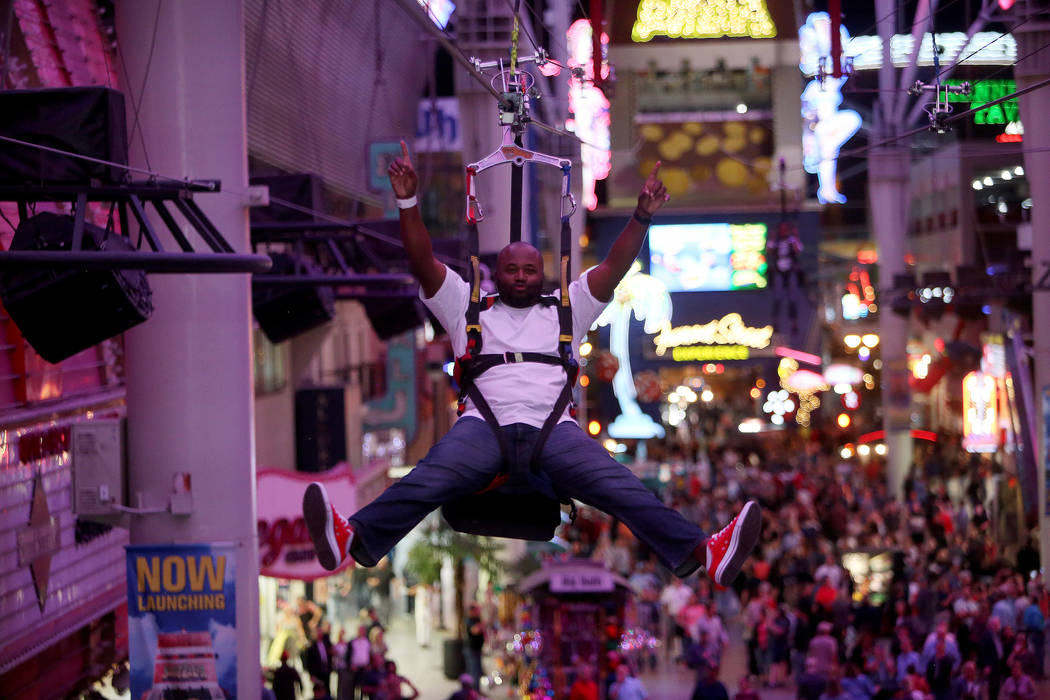 R.J. Brooks on the SlotZilla Zipline at the Fremont Street Experience in Las Vegas, Thursday, Nov. 1, 2018. Participants start near Las Vegas Boulevard, then fly over crowds and casinos to the oth ...