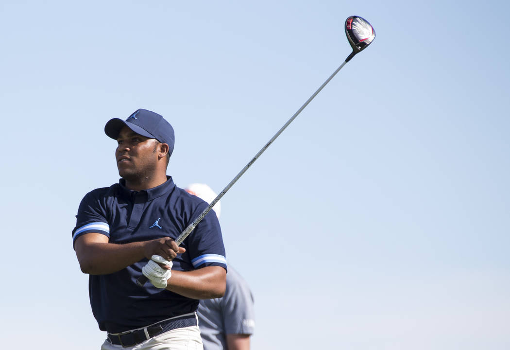 Harold Varner III watches his drive from the 18th tee box during the first round of the Shriners Hospitals For Children Open tournament at TPC at Summerlin in Las Vegas on Thursday, Nov. 1, 2018. ...