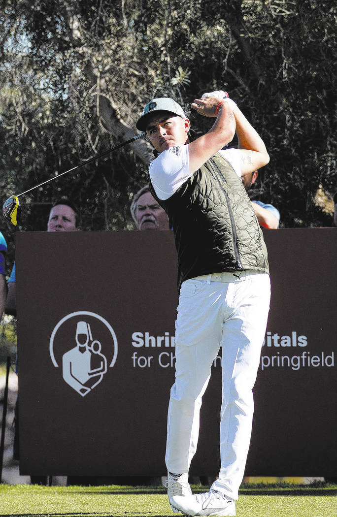 Rickie Fowler watches his drive from the ninth tee box during the first round of the Shriners Hospitals For Children Open tournament at TPC at Summerlin in Las Vegas on Thursday, Nov. 1, 2018. Ric ...