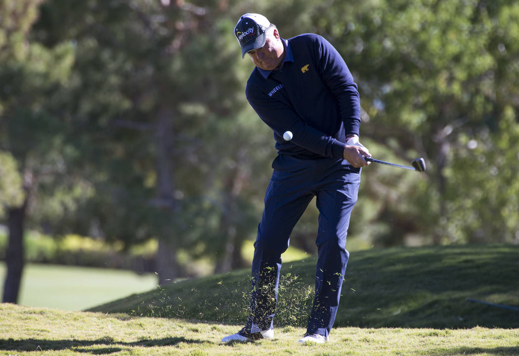 Kenny Perry takes a shot from the rough on the seventh during the first round of the Shriners Hospitals For Children Open tournament at TPC at Summerlin in Las Vegas on Thursday, Nov. 1, 2018. Ric ...