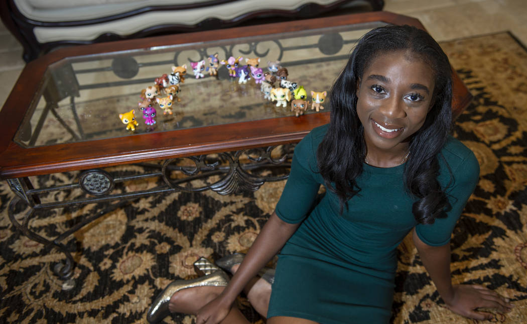 Nana Sarfo, 15, was 3 when she started collecting toy pets from Hasbro's Littlest Pet Shop. (Caroline Brehman/Las Vegas Review-Journal)