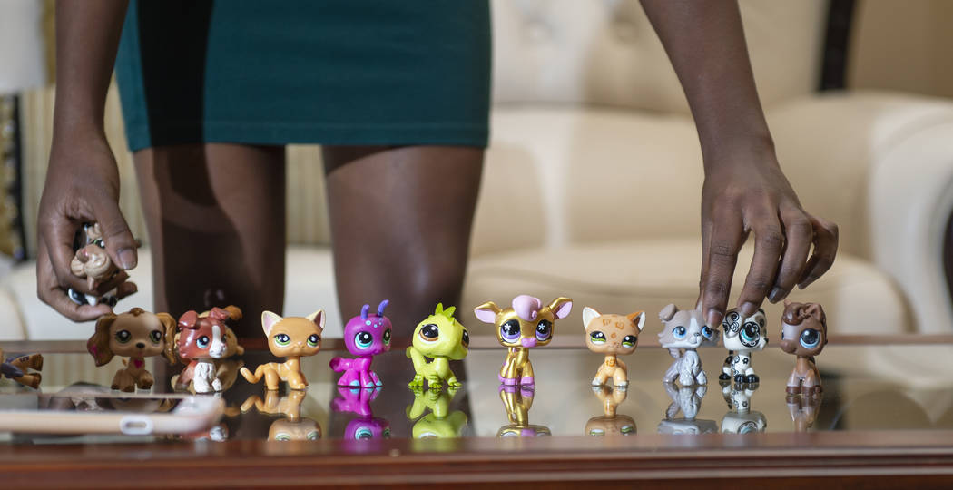 Nana Sarfo,15, lines up her collection of Littlest Pet Shop toys in her home in Las Vegas, Wednesday, Nov. 7, 2018. (Caroline Brehman/Las Vegas Review-Journal)