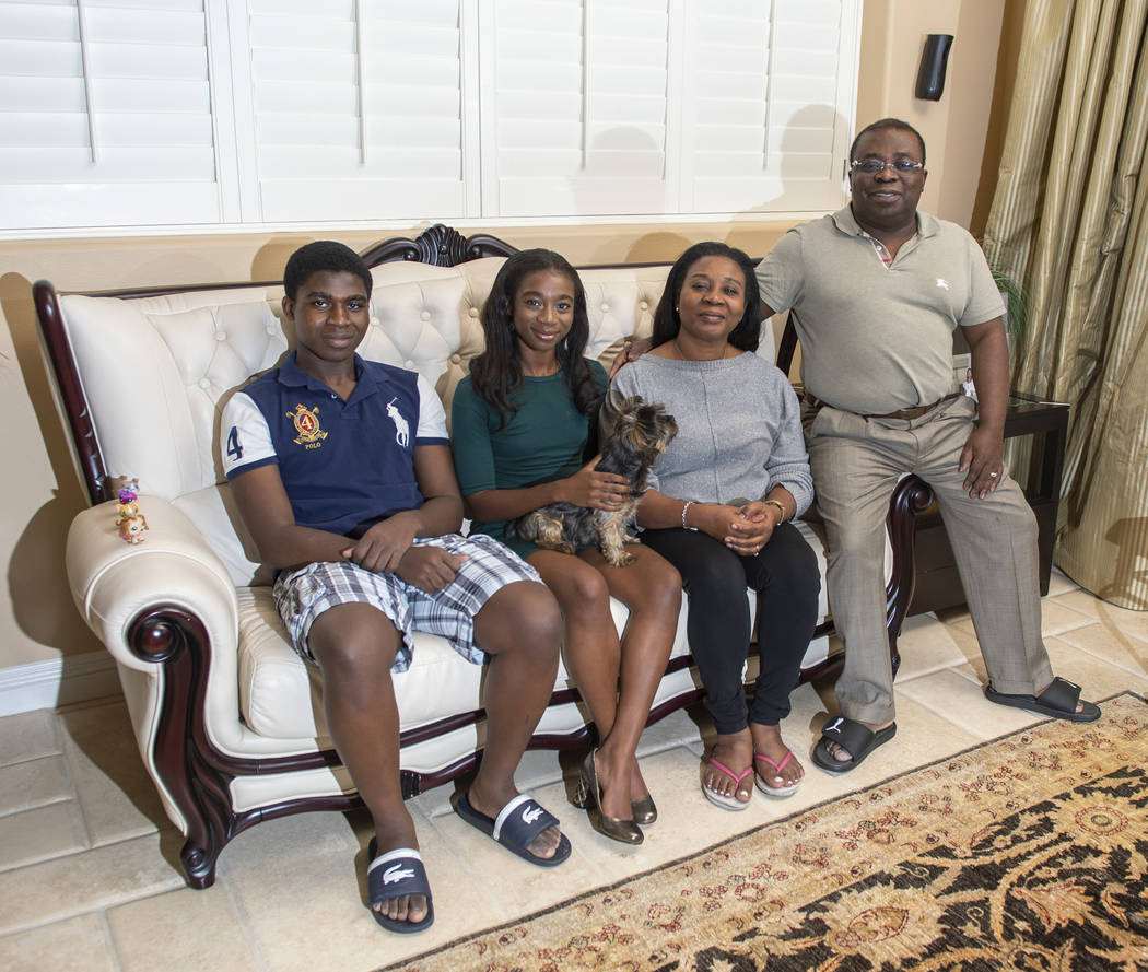 Nana Sarfo, 15, with brother Kobby, mother Rose, father Kofi and dog Victory in her home in Las Vegas, Wednesday, Nov. 7, 2018. (Caroline Brehman/Las Vegas Review-Journal)