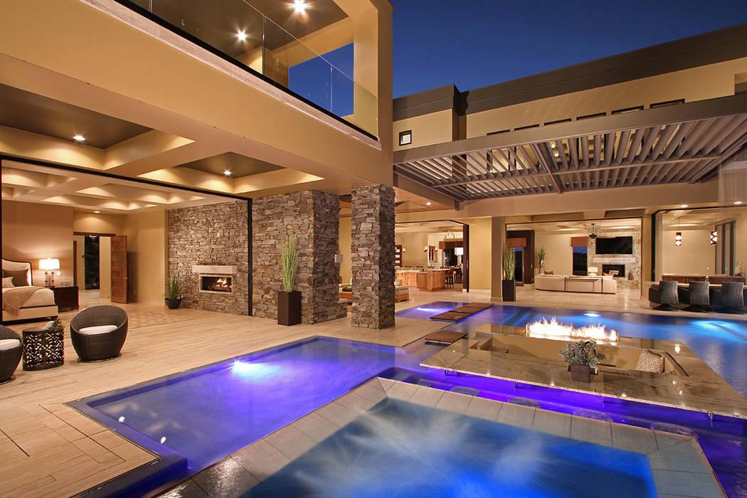 Sun West Custom Homes No. 5 731 Dragon Ridge Drive in MacDonald Highlands sold for $7.75M.