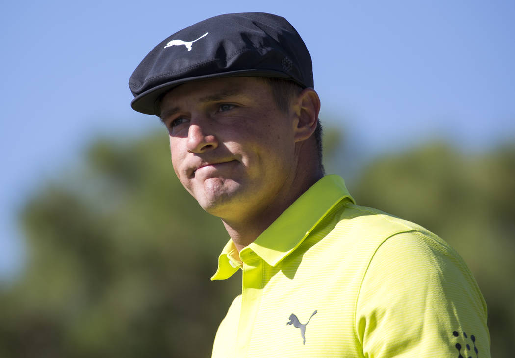 Bryson DeChambeau walks to the fairway after teeing off from the first box during the third round of the Shriners Hospitals for Children Open tournament at TPC at Summerlin in Las Vegas on Saturda ...