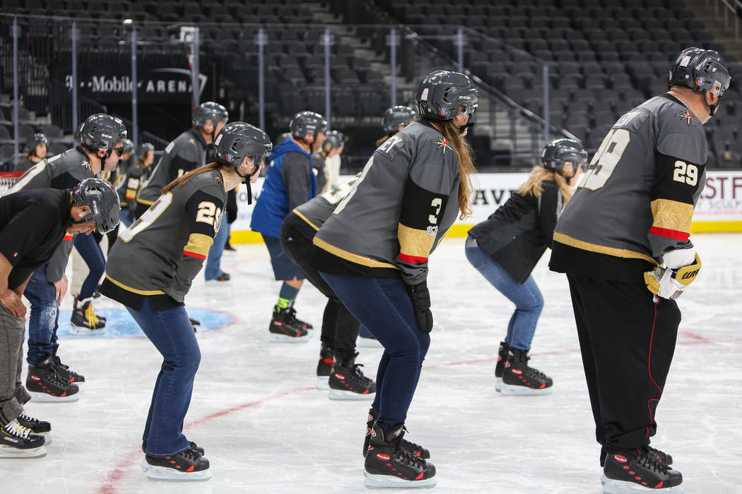 People attending a VGK University Hockey 101 session bend their knees as they are taught basic skating skills by Misha Donskov, Director of Hockey Operations at T-Mobile Arena in Las Vegas, Wednes ...