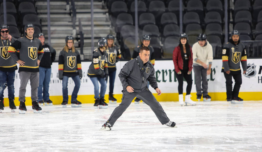 Misha Donskov, Director of Hockey Operations, teaches basic skating skills to a group gathered for a VGK University Hockey 101 session at T-Mobile Arena in Las Vegas, Wednesday,Oct. 24, 2018. Caro ...