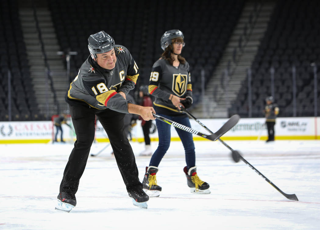 A man attending a VGK University Hockey 101 practices skating with a stick as the group gathered for the session is taught basic skating skills by Misha Donskov, Director of Hockey Operations at T ...