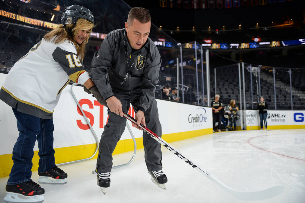 Misha Donskov, Director of Hockey Operations, teaches basic skating skills to a group gathered for a VGK University Hockey 101 session at T-Mobile Arena in Las Vegas, Wednesday, Oct. 24, 2018. Car ...