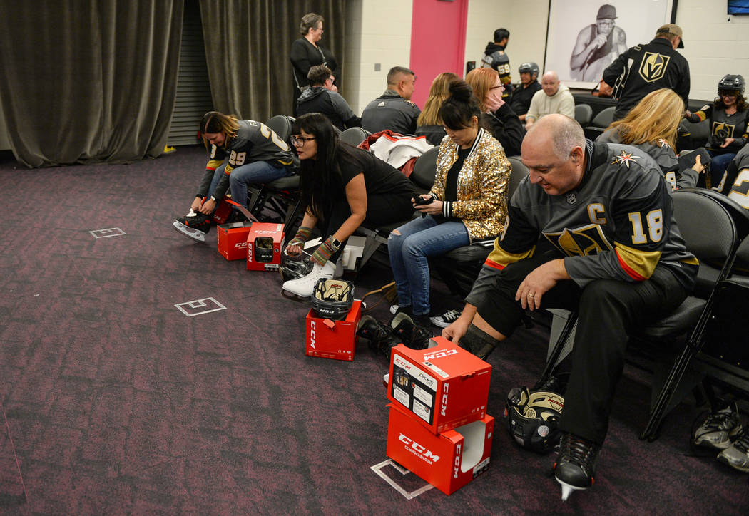 A group gathered for a VGK University Hockey 101 session takes off their skates after learning skating and hockey basics on the ice at T-Mobile Arena in Las Vegas, Wednesday,Oct. 24, 2018. Carolin ...