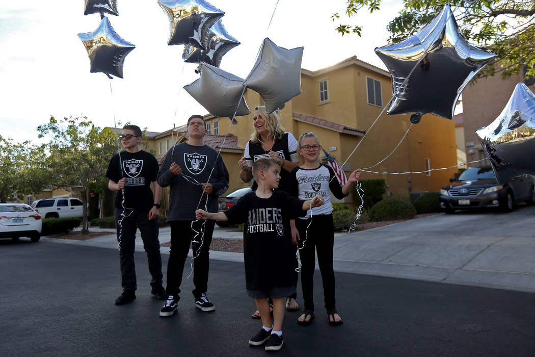 The Tracy family, from left, Kevin Tracy, 14, Colin Tracy, 17, Meredith Tracy, Callie Tracy, 9, and Kannon Tracy, 5, release balloons in honor of Russell Tracy's birthday outside their home in Las ...