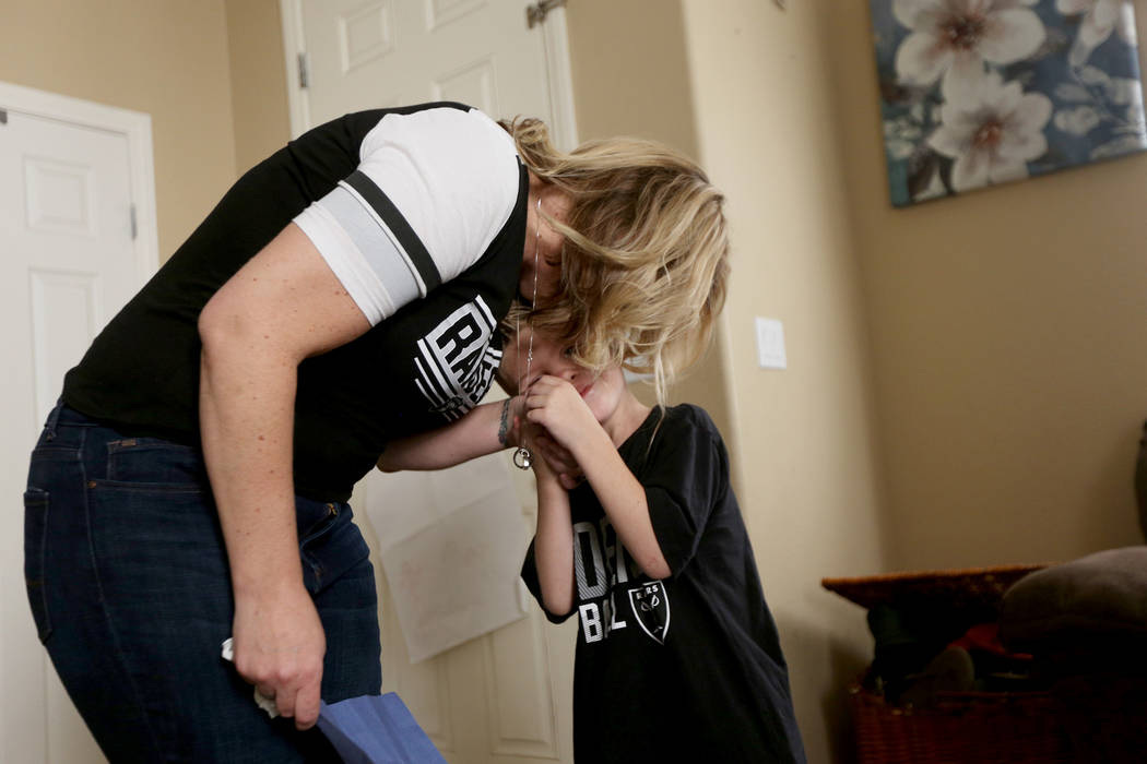 Meredith Tracy hugs Kannon Tracy, 5, at their home in Las Vegas, Friday, Nov. 2, 2018. Meredith's husband, Russell Tracy, was killed a year ago in a construction accident. Because he was a passion ...