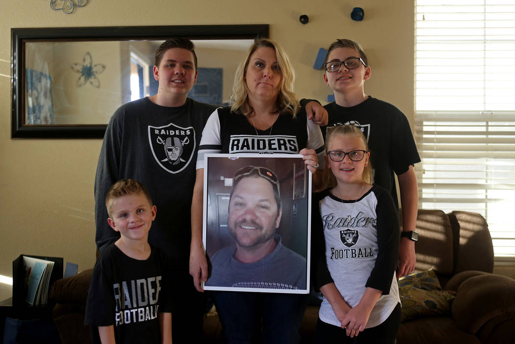The Tracy family, from left, Colin Tracy, 17, Kannon Tracy, 5, Meredith Tracy, Kevin Tracy, 14, and Cali Tracy, 9, at their home in Las Vegas, Friday, Nov. 2, 2018. Russell Tracy, husband and fath ...