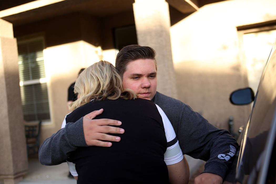 Meredith Tracy embraces her son Colin Tracy, 17, at their home in Las Vegas, Friday, Nov. 2, 2018. Russell Tracy, husband and father, was killed a year ago in a construction accident. Because he w ...