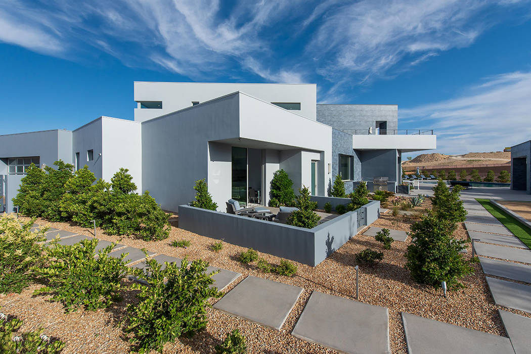 The home is landscaped to show off its modern design. (Steve Morgan)
