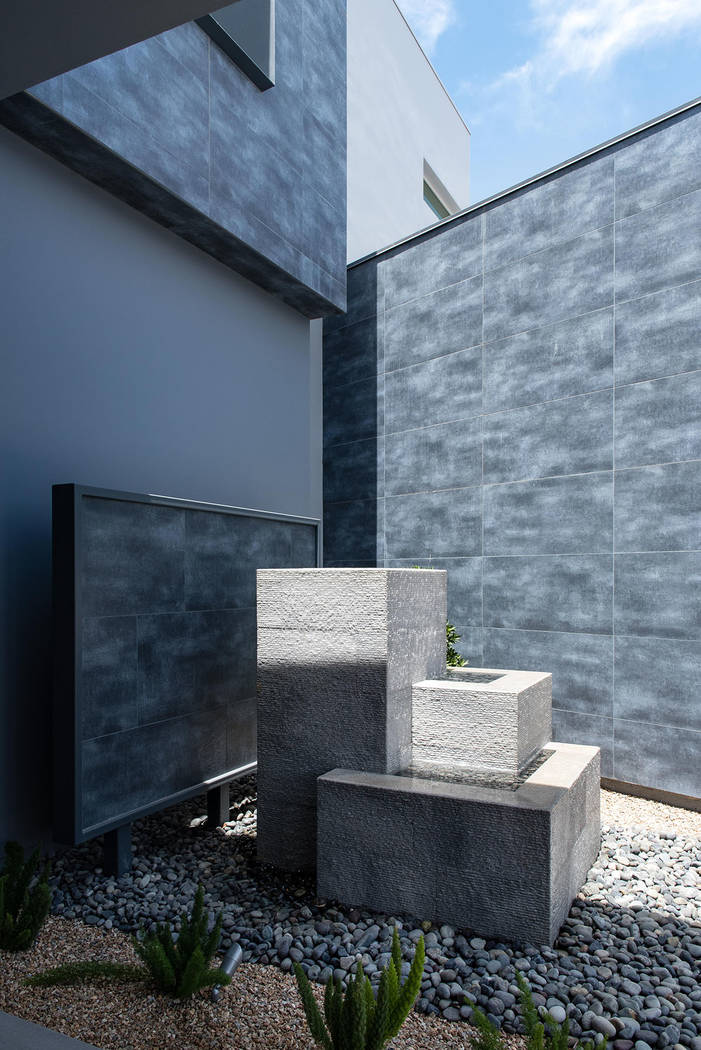 A water feature graces the front of the home. (Steve Morgan)