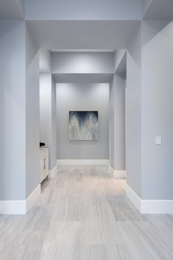 The hallway is perfect for a display of art. (Steve Morgan)