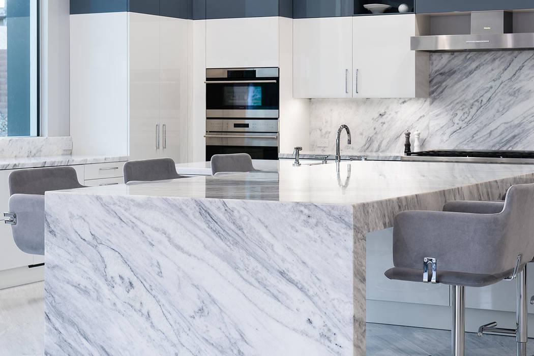 The kitchen has white and cobalt Scavolini cabinets. (Steve Morgan)