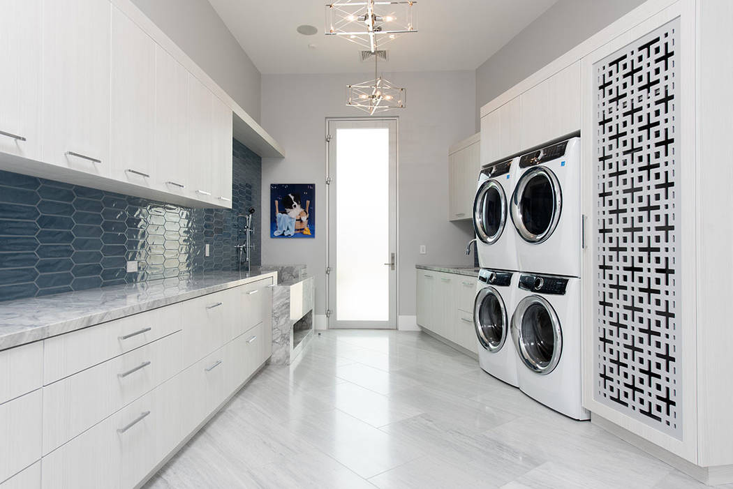 The laundry room is large and has a dog washing station. (Steve Morgan)