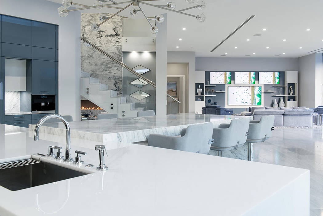 The kitchen has a marble waterfall-edge island with bar seating. (Steve Morgan)