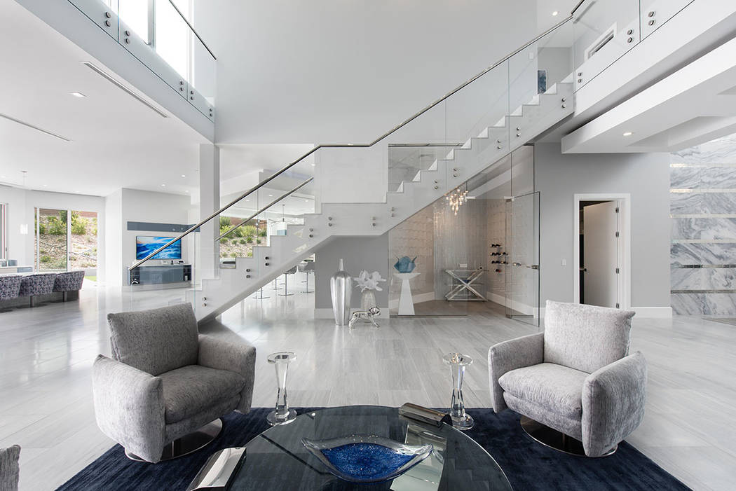 The 12,025-square-foot home has a continuous color palette of white, gray and blue. (Steve Morgan)