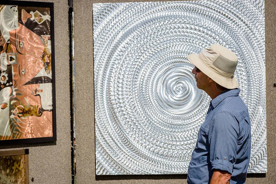 A man looks at art at the Summerlin Festival of Arts. (Summerlin)