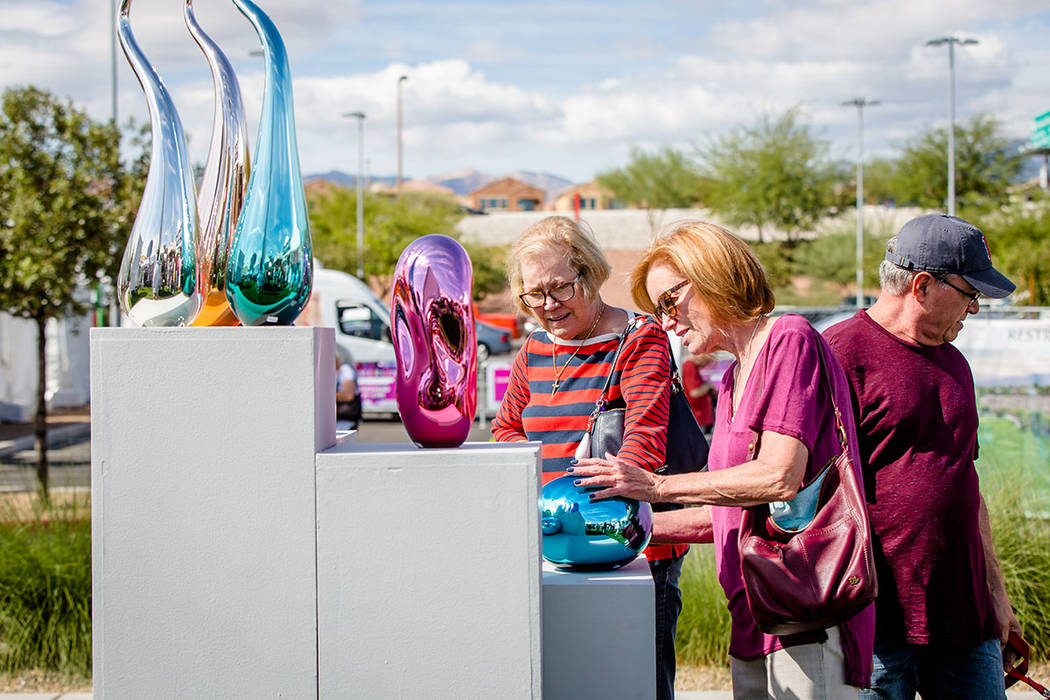 Women look at one of several artists booths at the Summerlin Festival of Arts. (Summerlin)