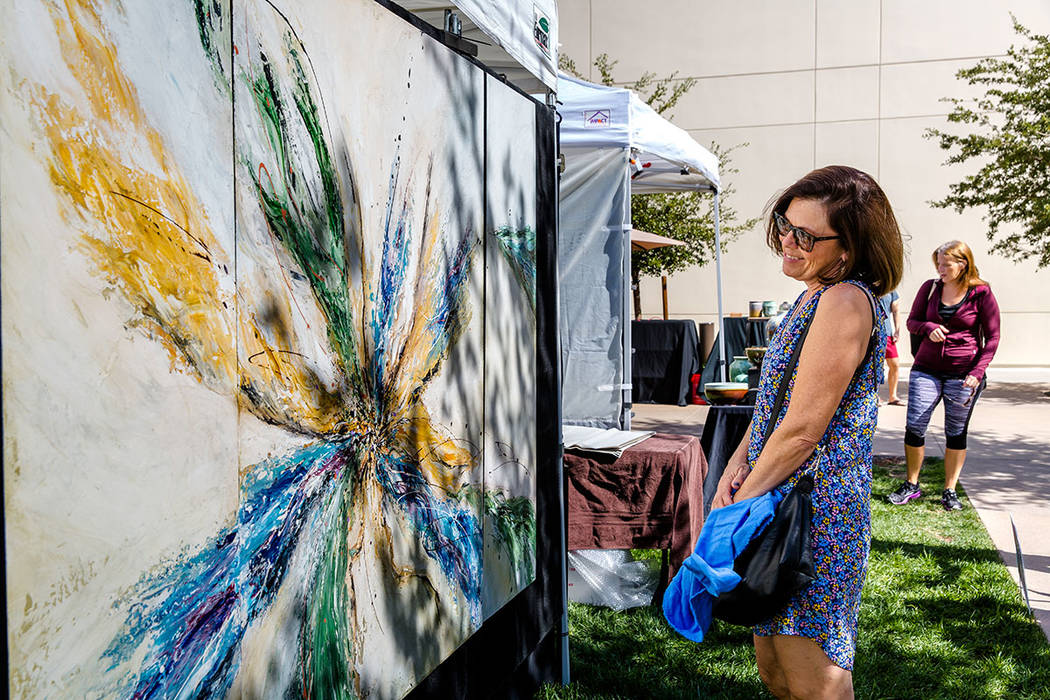 A woman admires an artist's work at the Summerlin Festival of Arts, which was held Oct. 13-14. (Summerlin)