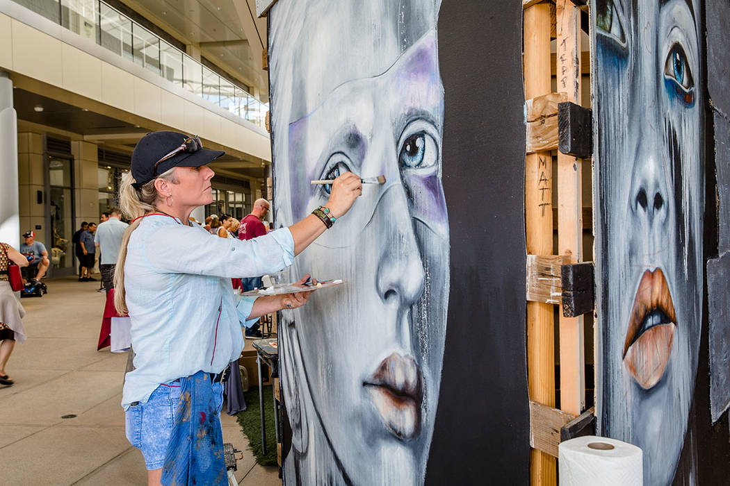 An artist works on a painting at the Summerlin Festival of Arts. (Summerlin)