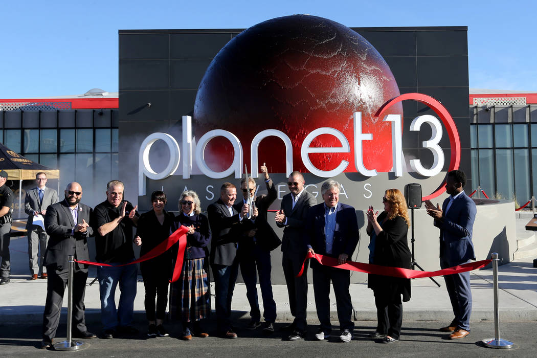 Owners and dignitaries cut the ribbon to open Planet 13, which bills itself as one of the largest dispensaries in the world, to open its doors to the public Thursday, Nov. 1, 2018.The marijuana st ...