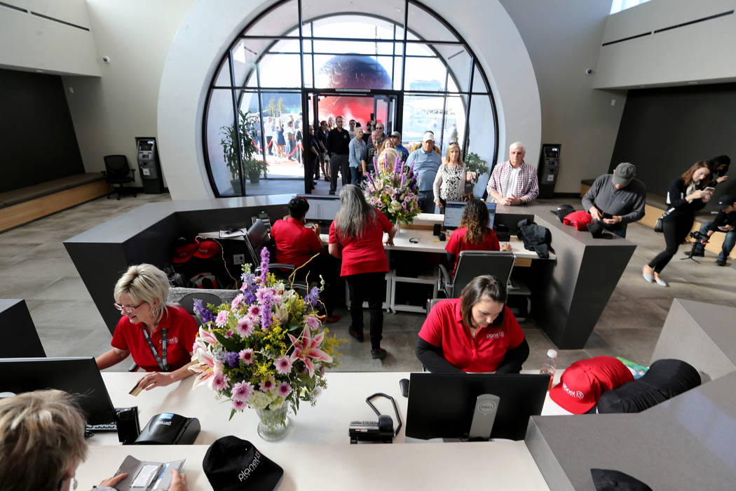 The first customers file into Planet 13, which bills itself as one of the largest dispensaries in the world, Thursday, Nov. 1, 2018. The marijuana store is located near the intersection of Desert ...