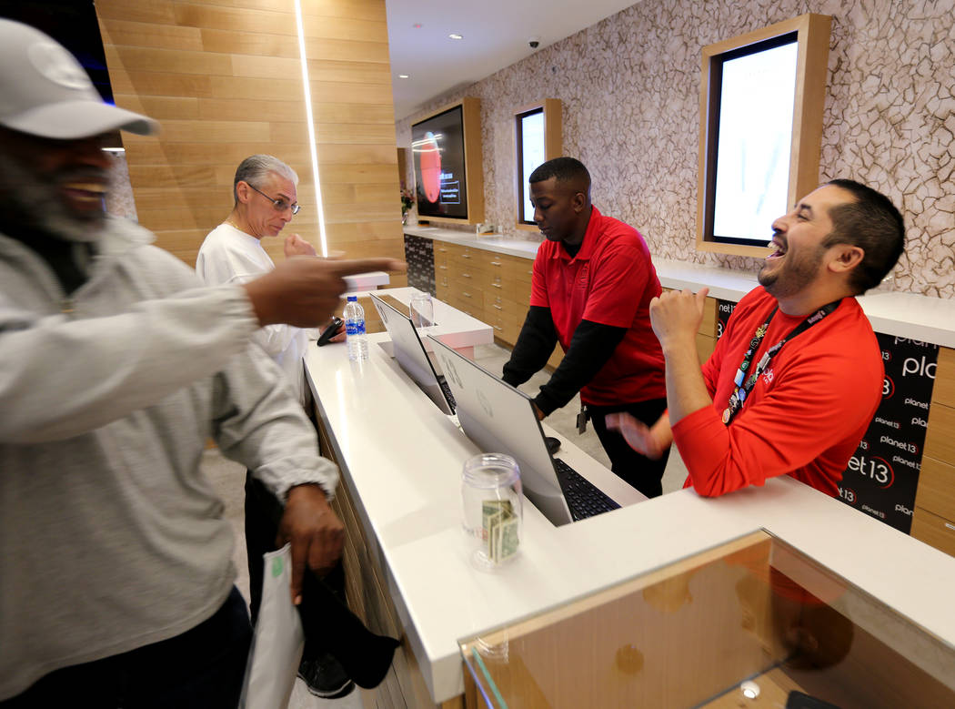 Budtender Robert Martinez, right, helps customer George Jennings of Las Vegas at Planet 13, which bills itself as one of the largest dispensaries in the world, Thursday, Nov. 1, 2018. The marijuan ...