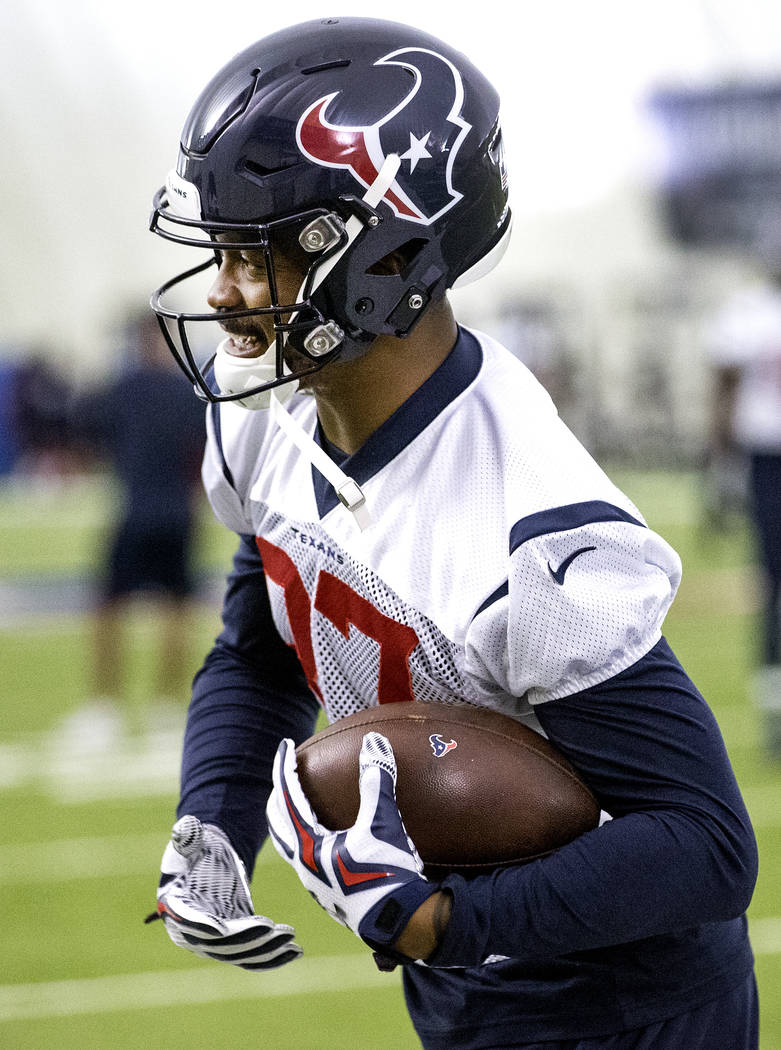 Houston Texans wide receiver Demaryius Thomas catches the ball during NFL football practice in Houston, Wednesday, Oct. 31, 2018. Demaryius Thomas' trade from the Denver Broncos to the Houston Tex ...