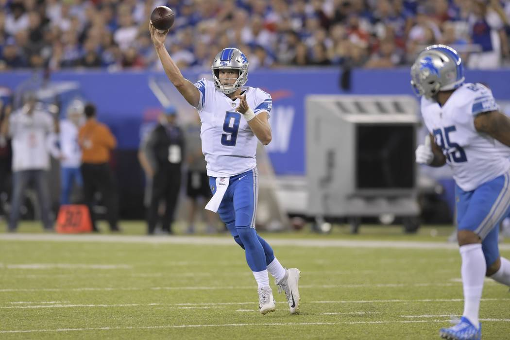 Detroit Lions quarterback Matt Stafford (9) throws a pass to Eric Ebron (85) during the first half of an NFL football game Monday, Sept. 18, 2017, in East Rutherford, N.J. (AP Photo/Bill Kostroun)
