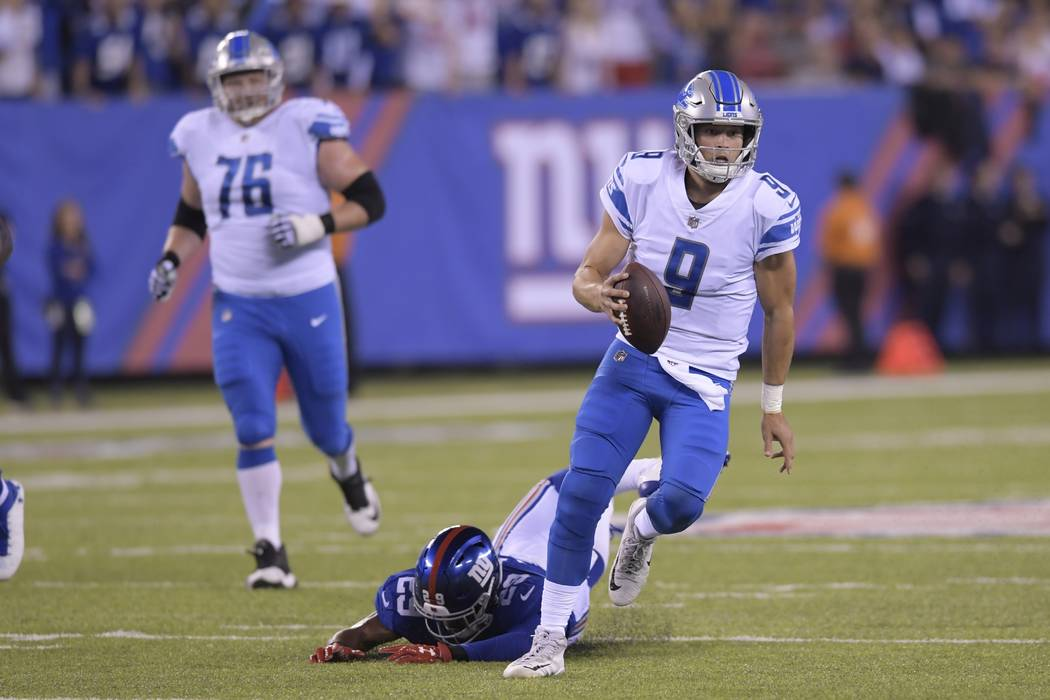 Detroit Lions quarterback Matt Stafford (9) rushes away form New York Giants' Nat Berhe (29) during the first half of an NFL football game Monday, Sept. 18, 2017, in East Rutherford, N.J. (AP Phot ...