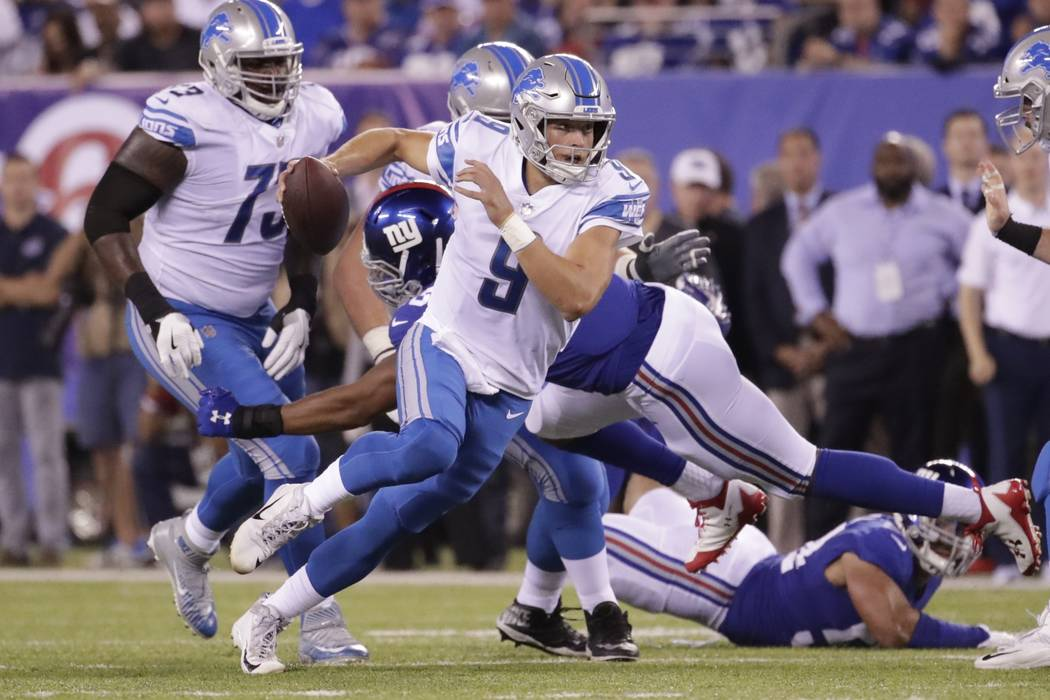 Detroit Lions quarterback Matt Stafford (9) rushes during the first half of an NFL football game against the New York Giants Monday, Sept. 18, 2017, in East Rutherford, N.J. (AP Photo/Julio Cortez)