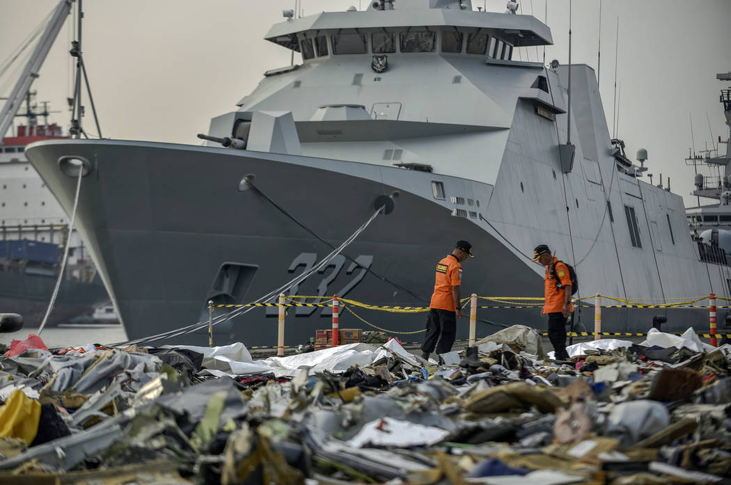 Members of National Search and Rescue Agency inspect debris retrieved from the waters where Lion Air flight JT 610 is believed to have crashed, at Tanjung Priok Port in Jakarta, Indonesia, Wednesd ...
