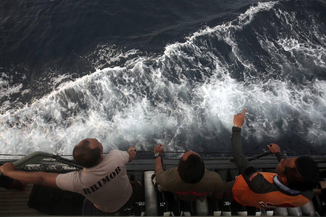 Rescuers scan the horizon during a search operation for the victims of Lion Air plane crash in the waters of Tanjung Karawang, Indonesia, Wednesday, Oct. 31, 2018. A massive search effort has iden ...