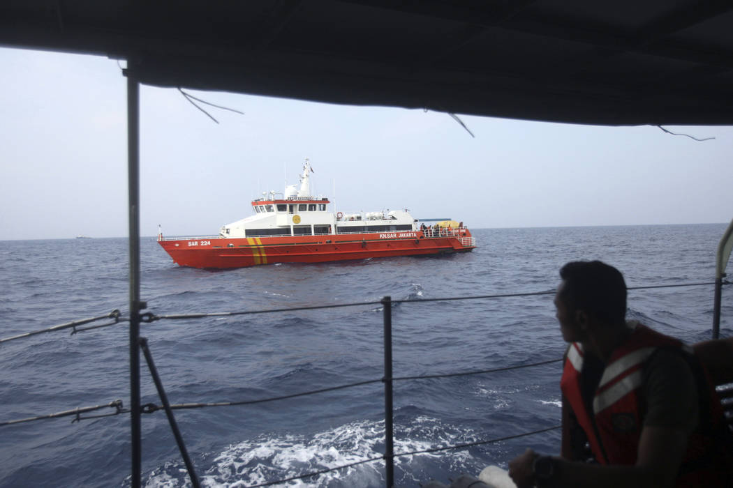 Rescue ships conduct a search operation for the victims of Lion Air plane crash in the waters of Tanjung Karawang, Indonesia, Wednesday, Oct. 31, 2018. A massive search effort has identified the p ...