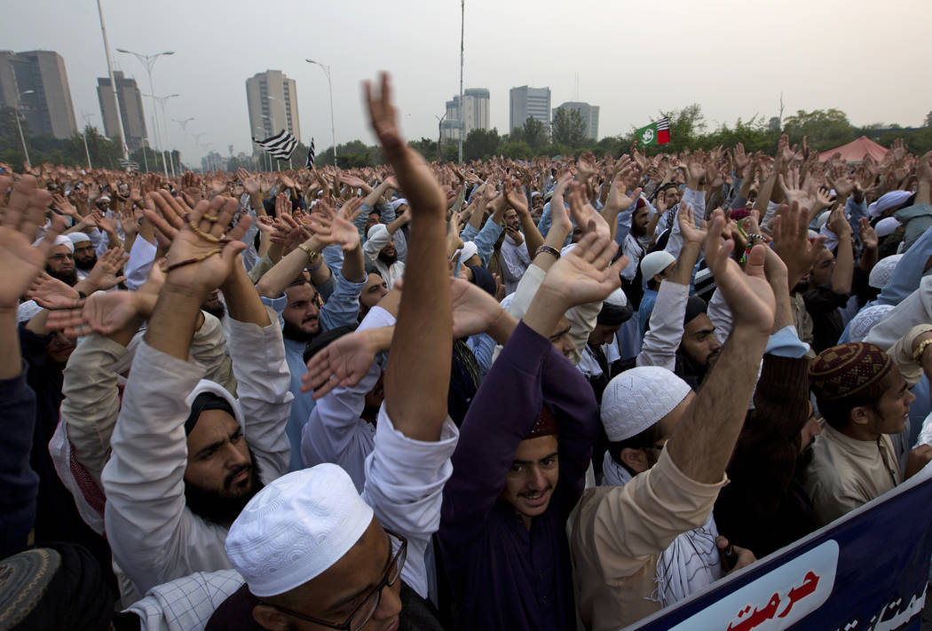 Pakistan religious students and other protesters raise their hands to condemn Supreme Court's decision in favor of a Christian woman Asia Bibi, in Islamabad, Pakistan, Wednesday, Oct. 31, 2018. Pa ...