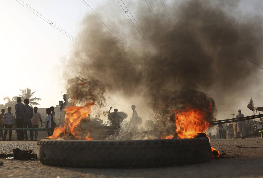Pakistani protesters burn tires while blocking a main road during a protest after a court decision, in Karachi, Pakistan, Thursday, Nov. 1, 2018. Asia Bibi, a Christian woman who spent eight year ...